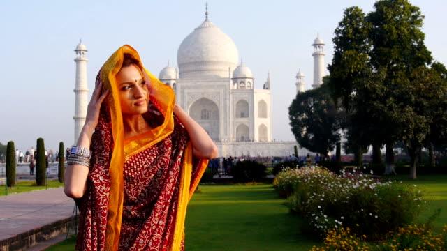 Woman wearing sari at Taj Mahal in India video