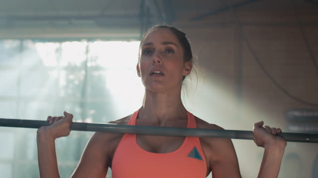Woman weightlifting in gym video