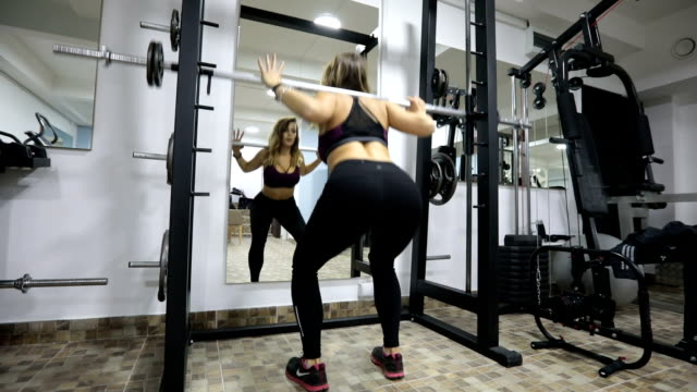 Woman weightlifting training video