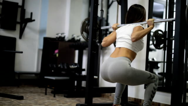 Woman weightlifting video