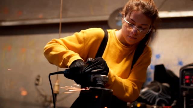 Woman welder in workshop video