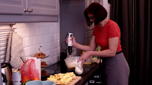 Woman whips charlotte pie dough mixer video