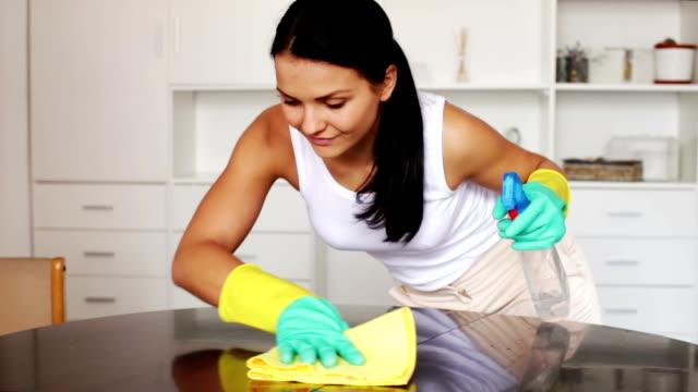 woman wipes a dust rag video