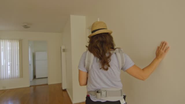 Woman with baby checking out a new apartment video