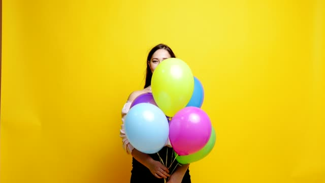 Woman with ballons at studio video