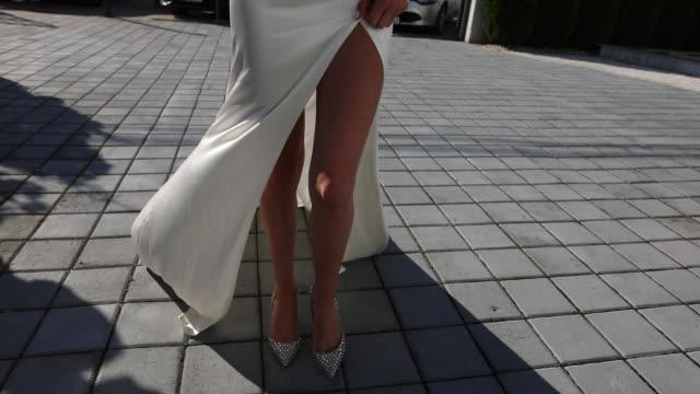 Woman with beautiful legs walking on high heels video