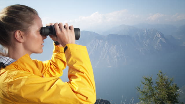 Woman with binoculars video