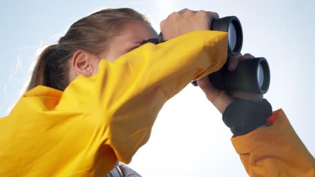 Woman with binoculars video