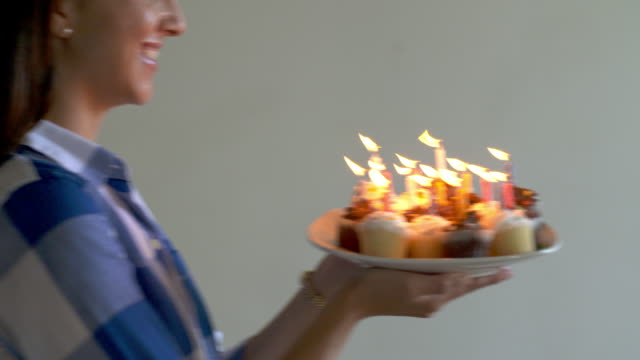 Woman with Birthday Cake video