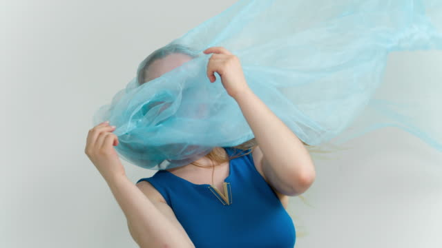 Woman with blue fabric on head video