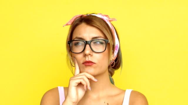 4k woman with bright idea - question mark video stock e b–roll