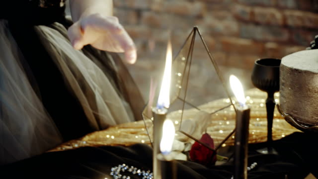 Woman with candles divination magic video