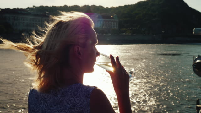 a woman with champagne on board the ship. cruise on the river, tourism in europe - cruise video stock e b–roll