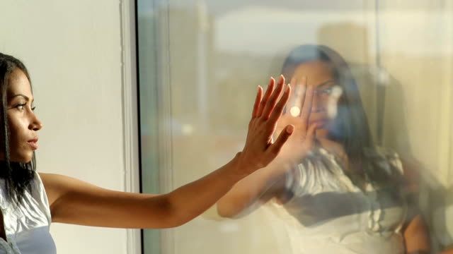 Woman With Complexes Reflected in Window video