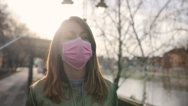 woman with face protective mask - mascherina video stock e b–roll