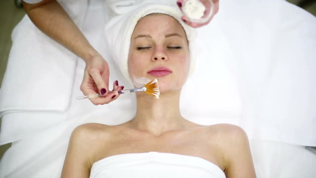 Woman with facial mask in spa video
