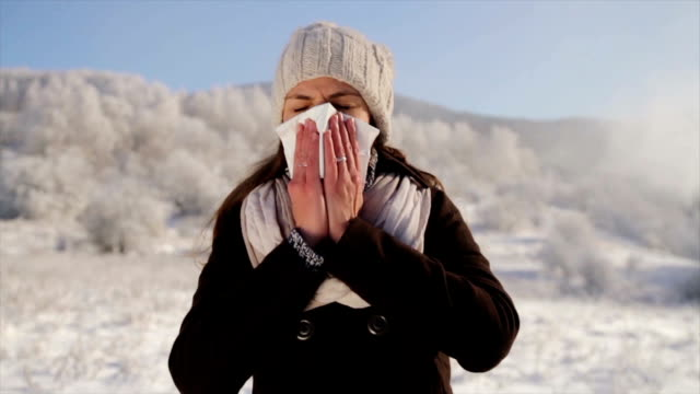 Woman with Flu Blowing Nose Outdoors Winter video