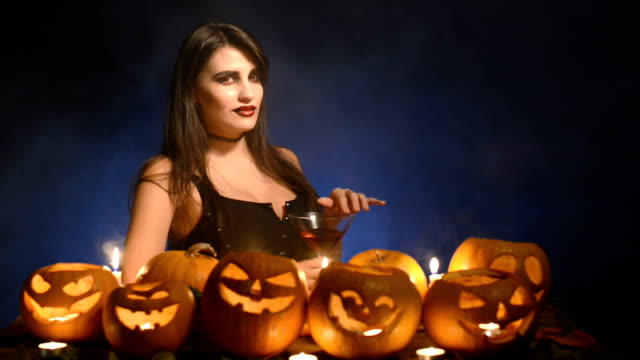 Woman with Halloween pumpkins video