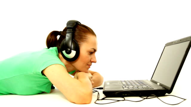 Woman with headphones and laptop, isolated video