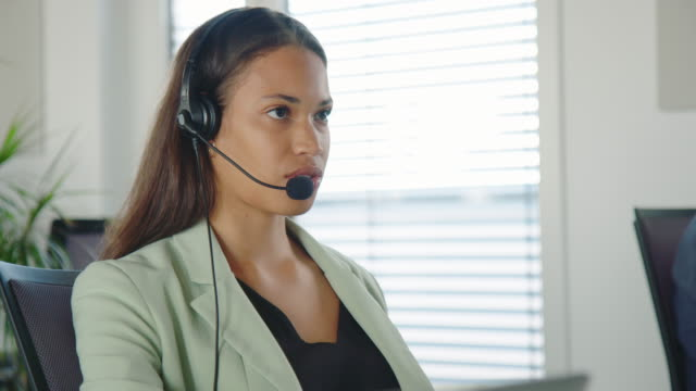 Woman with headset on call with a customer