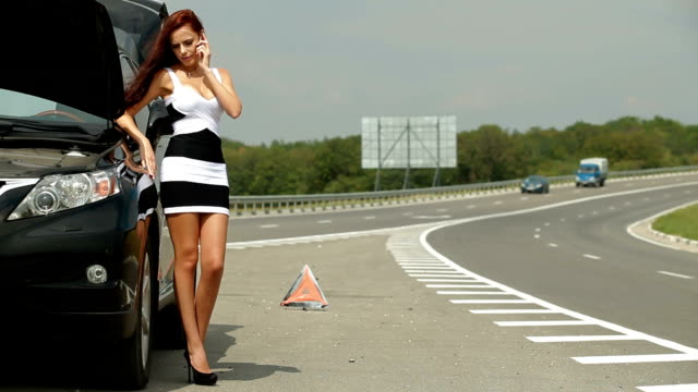 Woman with her Broken Car video