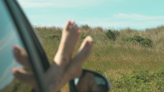 kvinna med hennes fötter upp i fönstret bil - summer sweden bildbanksvideor och videomaterial från bakom kulisserna