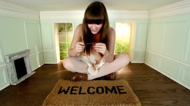 Woman with key on welcome mat video