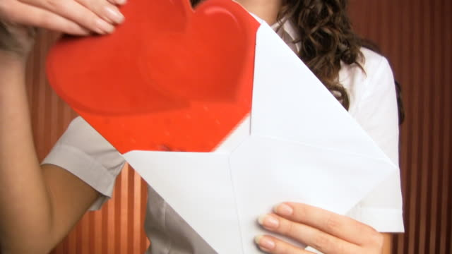 Royalty free anniversary card hd video 4k stock footage b roll hd woman with love letter video thecheapjerseys Image collections