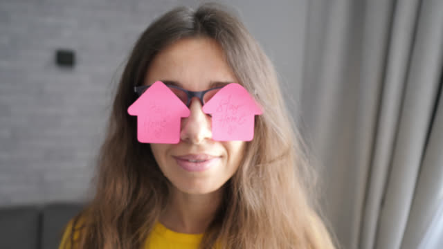 Woman with pink stickers on glasses with text stay home. Quarantine virus concept. Motivation quote