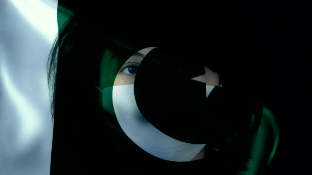 Woman with Protective Face Mask on Pakistani Flag. Protection for Viruses and Infections.