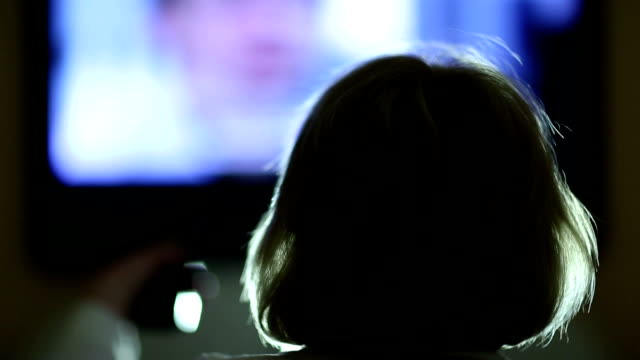 Woman with remote control switching tv channels Woman with remote control switching tv channels. Back of the head changing channels stock videos & royalty-free footage