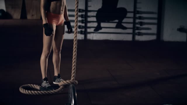 Woman with rope in gym video