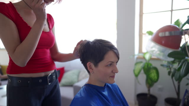 Woman with short hair in hairdressing salon Female customer with short hair  getting hair cut by owner of  hair salon short hair stock videos & royalty-free footage