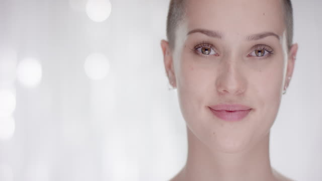 Woman with short hair looks up in to the camera video