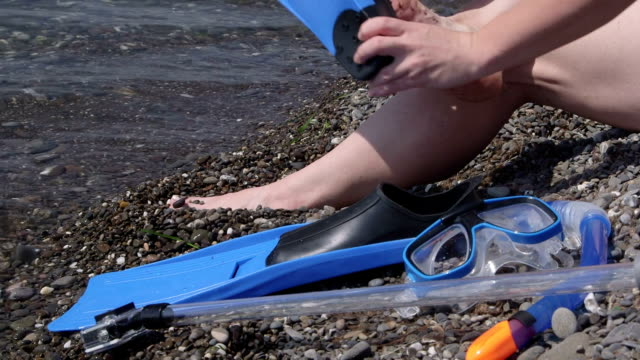 Woman with snorkeling set going to swim in sea video