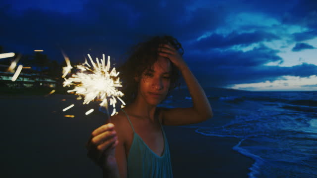 woman with sparkler at sunset - beach fashion stock videos and b-roll footage