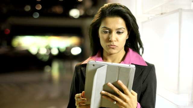 woman with tablet pc in front of bright wall video