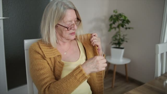 Woman with thermometer checking temperature