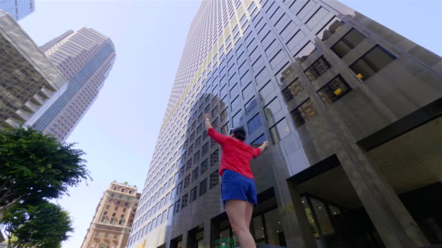 Woman with virtual reality device near high skycrapers in Los Angeles in 4k slow motion 60fps