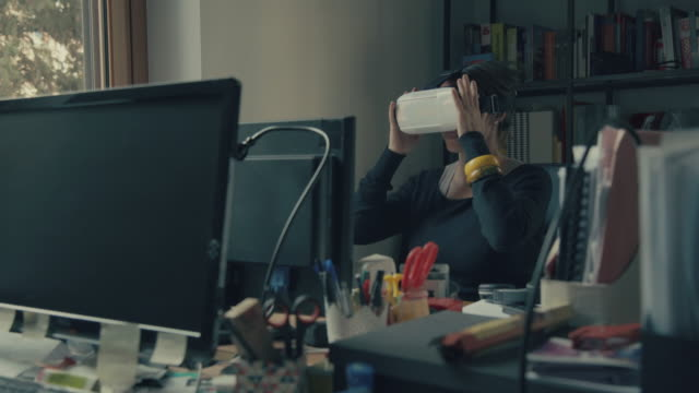 Woman with VR headset augmented reality at office video