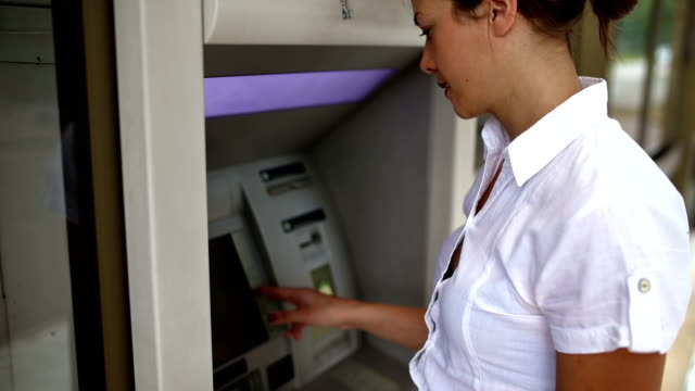 Woman withdrawing money at the ATM