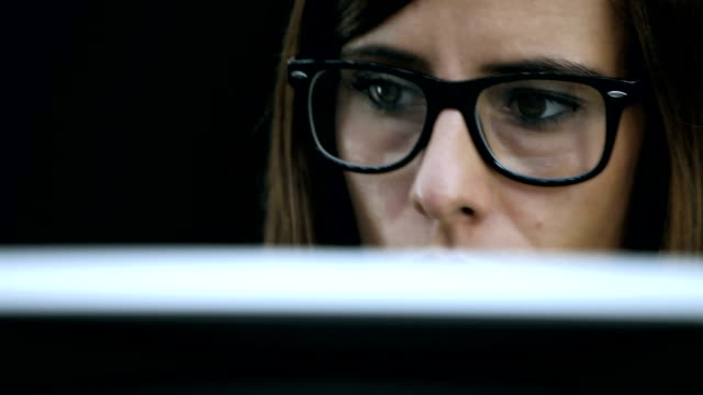 Woman work at computer video