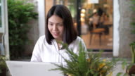 istock Woman working and using with laptop at cafe , SLOW MOTION 1204354190