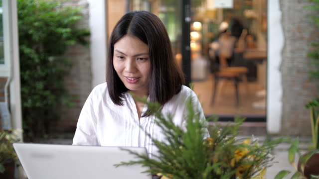 Woman working and using with laptop at cafe , SLOW MOTION