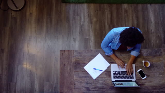 Woman Working at Laptop from Above - video