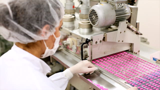 Woman working at the pharmaceutical factory video