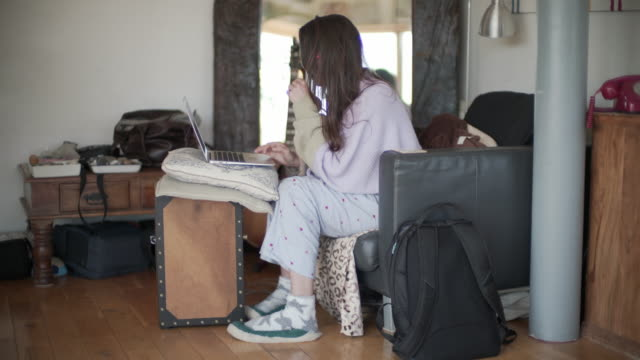 A woman working from home in her Pj's