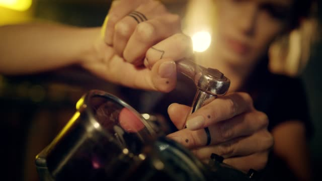 woman working in motorcycle workshop. close up on hands - mechanic video stock e b–roll