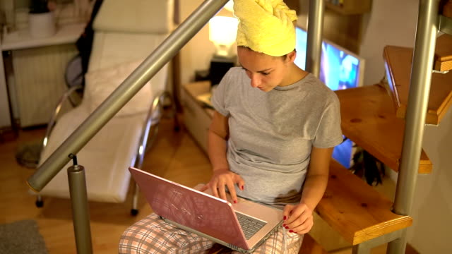 Woman working in pajamas on her laptop video