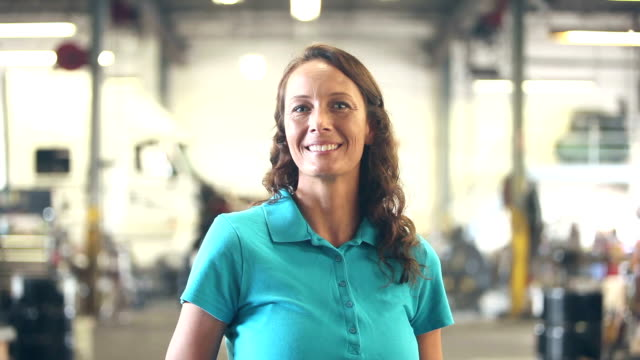 Woman working in trucking industry, smiling at camera video